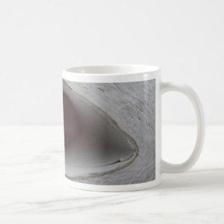 eye shaped hole made of paper mugs