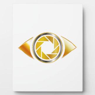 Eye with aperture symbolizing photographic eye photo plaques