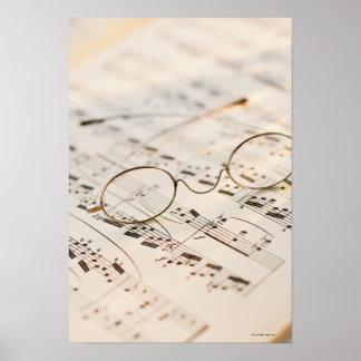 Eyeglasses on Sheet Music Poster