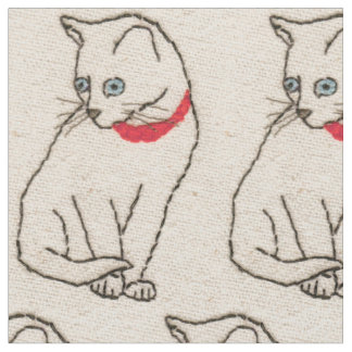 Fabric featuring embroidered cat image