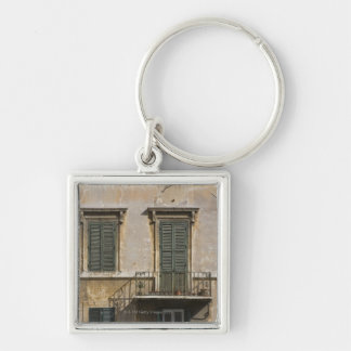 facade of building with a balcony and shuttered Silver-Colored square key ring