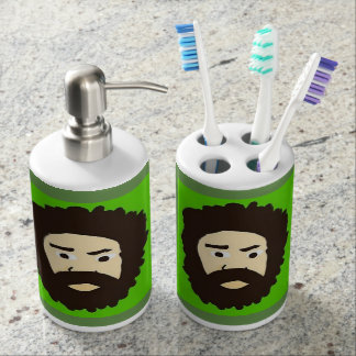 face cartoon with green background soap dispenser and toothbrush holder