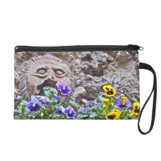 """FACE IN STONE WALL WITH PANSIES"" WRISTLET"