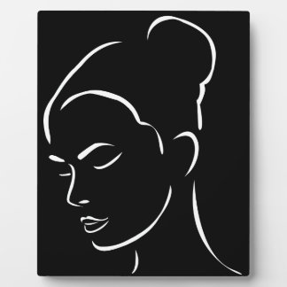 Face of a beautiful young woman display plaque