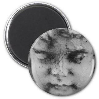 Face of a cherub 6 cm round magnet