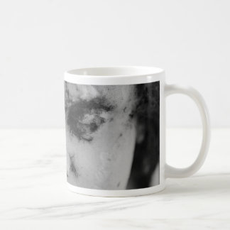 Face of a cherub coffee mug
