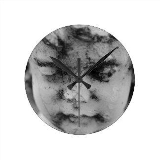 Face of a cherub round clock