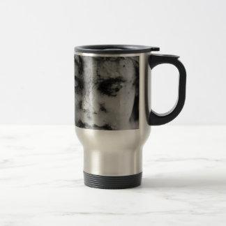 Face of a cherub travel mug