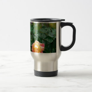 Fades wet rose with drops of  rain travel mug