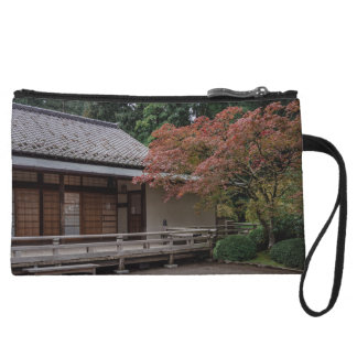 Fall colors in the garden wristlet purse