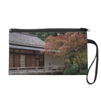 Fall colors in the garden wristlet purses