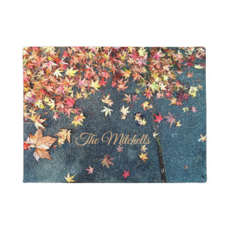 Fall leaves on pavement doormat