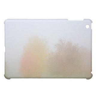Fall trees shrouded in mist iPad mini cases