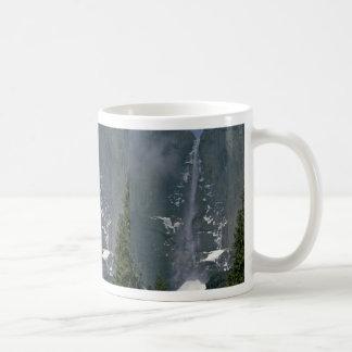 Falling On Snow Mugs