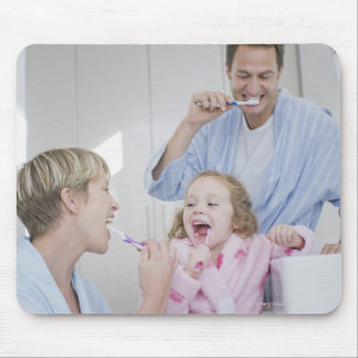 Family brushing teeth together mousepad