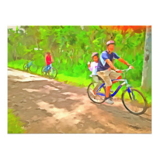 Family cycling on a dirt track photograph