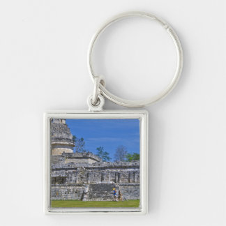 Family of tourists walk past ancient Mayan Silver-Colored Square Key Ring