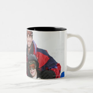 Family portrait with snowboards Two-Tone coffee mug