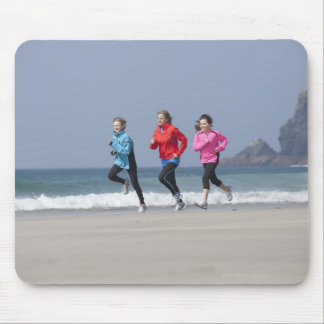 Family running together on beach mouse pad