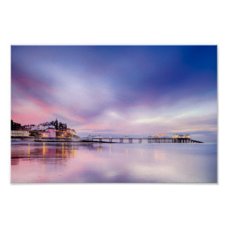 Famous Cromer pier in Norfolk England with pink su Poster