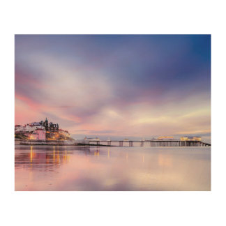 Famous Cromer pier in with pink sunset Wood Wall Art
