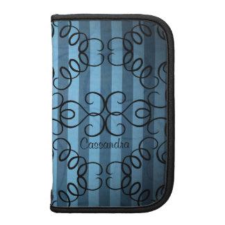 Fancy black swirl design on blue stripes folio planner