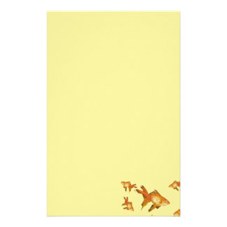 fancy gold goldfish swimming in aquarium stationery paper