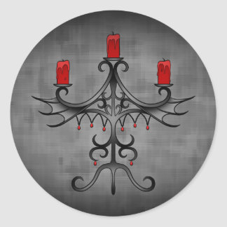 Fancy gothic candelabra on gray grunge round sticker