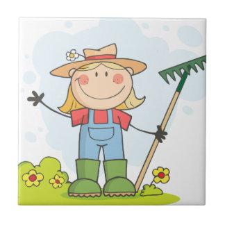 Farmer girl with a rake in grass tile