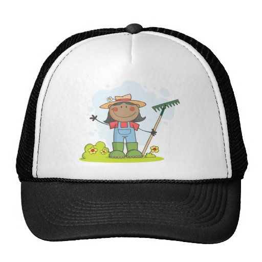 Farmer girl with a rake in grass with flowers mesh hats
