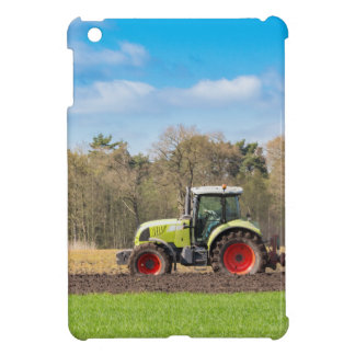 Farmer on tractor plowing sandy soil in spring iPad mini cover