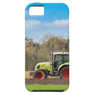 Farmer on tractor plowing sandy soil in spring iPhone 5 cases