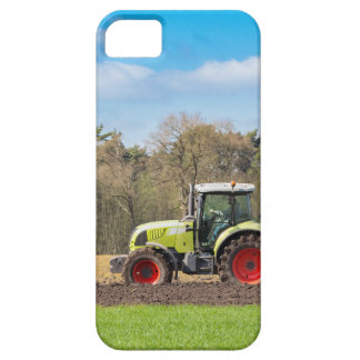 Farmer on tractor plowing sandy soil in spring iPhone 5 cover