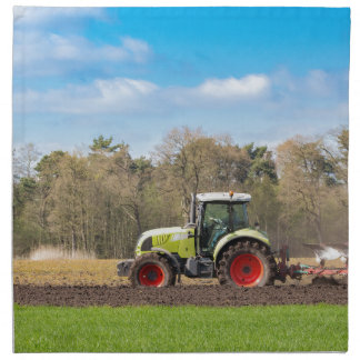 Farmer on tractor plowing sandy soil in spring napkin