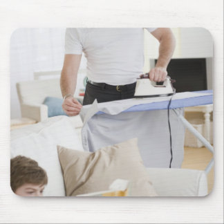 Father ironing mouse pad