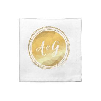 Faux gold metallic effect initial cloth napkins.
