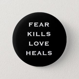 fear kills love heals 6 cm round badge