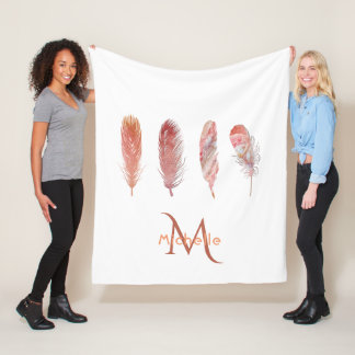 Feathers in pink and coral on white monogrammed fleece blanket