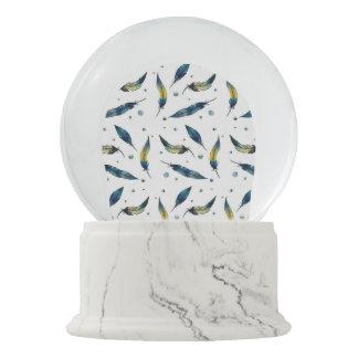 Feathers On White Snow Globe