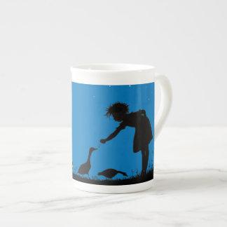 Feeding geese at midnight tea cup
