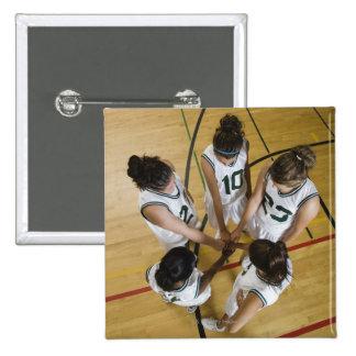 Female basketball team having group handshake pinback buttons