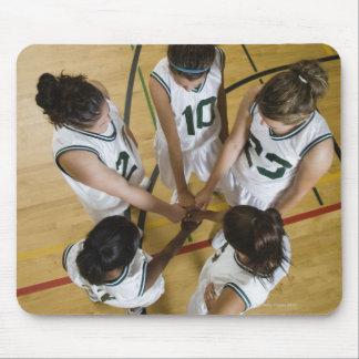 Female basketball team having group handshake, mousepad
