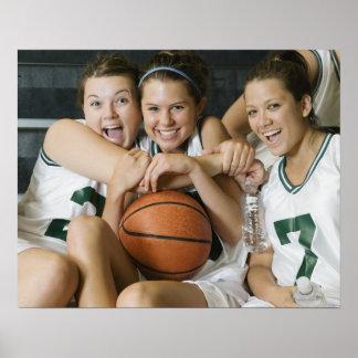 Female basketball team smiling, portrait poster