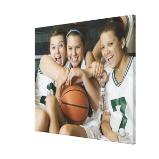 Female basketball team smiling, portrait stretched canvas print