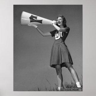 Female cheerleader using megaphone poster