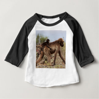 Female gelada baboon with a baby baby T-Shirt