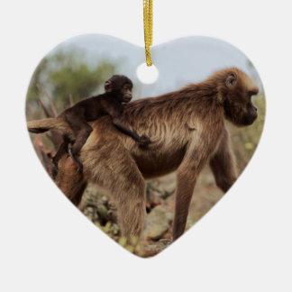 Female gelada baboon with a baby ceramic ornament