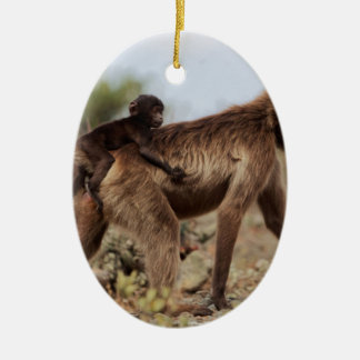 Female gelada baboon with a baby ceramic ornament