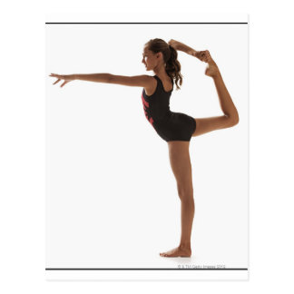 Female gymnast (12-13) balancing on one leg postcard