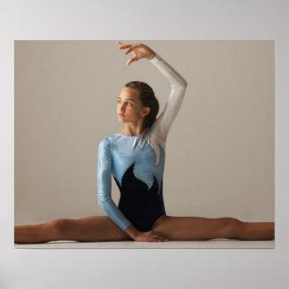 Female gymnast (12-13) performing splits poster